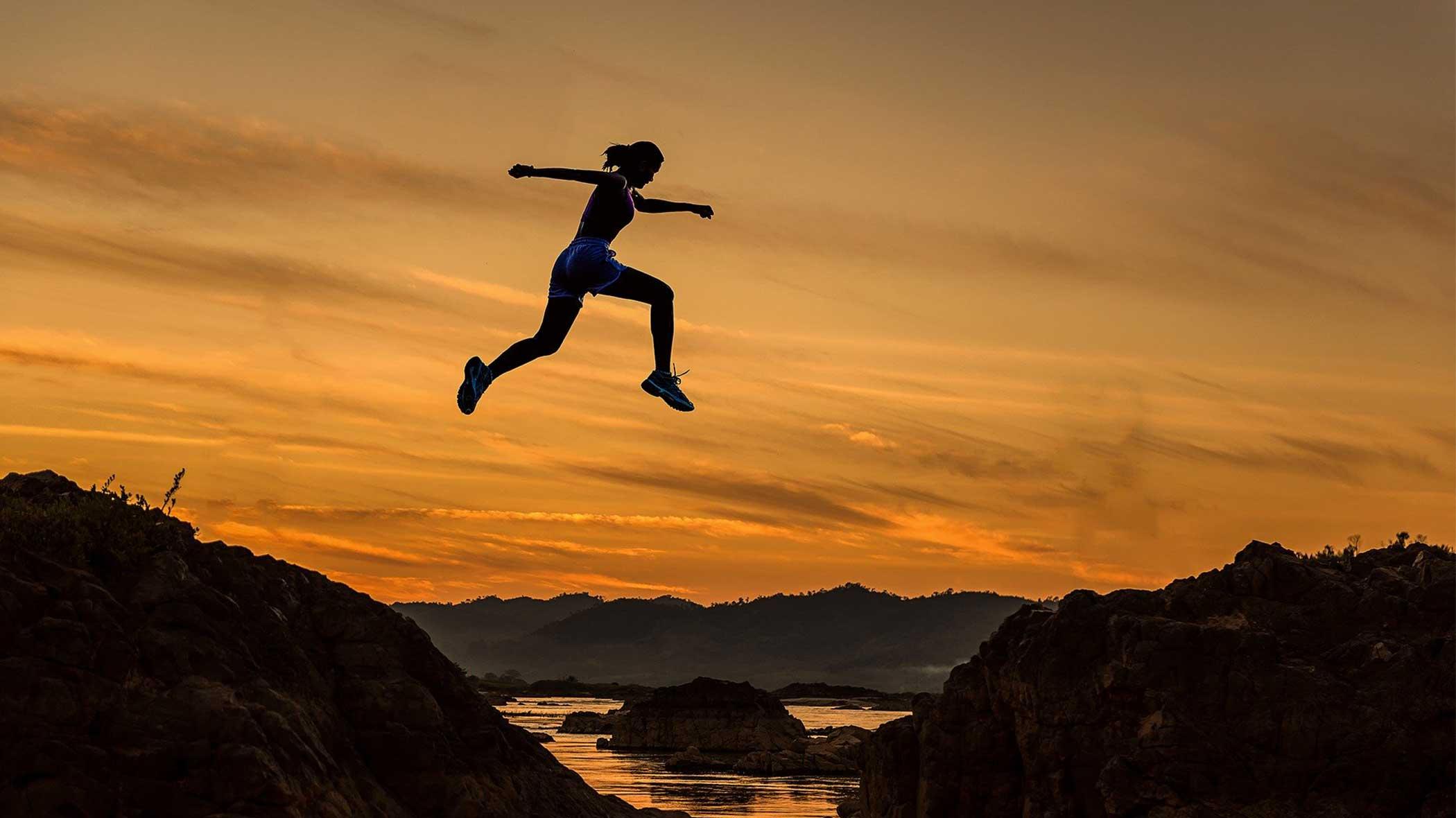 a women is doing a big jump